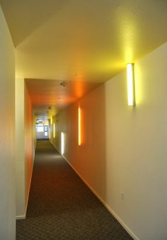 INTERIOR: corridor with window at end and colored lights. -Ironhorse