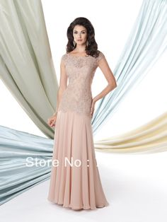 This Montage 114906 Mother-of-the-Bride dress by Mon Cheri flows elegantly to the floor. Made of soft opaque chiffon with a beaded lace dropped waist bodice. A scalloped bateau neckline and cap sleeves top the sweetheart dress beneath. Mother Of Groom Dresses, Bride Groom Dress, Bride Gowns, Mothers Dresses, Mother Of The Bride, Wedding Gowns, Prom Gowns, Ball Gowns, Mom Dress