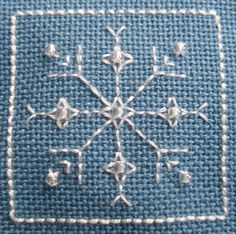 Snowflake 3, designed by @Lesley Bousbaine, tintocktap blogger for Snowflakes in the Snow 15-sided biscornu.
