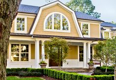 This shingle style Birmingham home has many characteristics including a charming farmhouse style front and a beautiful interior floor plan.