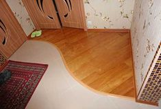 curvy joint for wood floor to ceramic tiles, entryway design and floor decoration