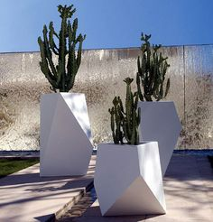 The Bysteel collection is an idea and expression container originated by the very simplicity of forms: the steel foil. The metalwork processing narrates all the conceptual path that the company has identified as own communicative mission. The Bysteel objects are inspired in Nature and return to Nature. cacti in large geometric modern containers.