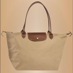 Longchamp Le Pliage Shopper Tote 100% authentic, French made nylon Longchamp tote in beige. Minimal signs of wear, great condition. Longchamp Bags Totes