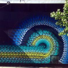 America, Miami-based artist Douglas Hoekzema (aka Hoxxoh) creates some fascinating and complex artworks, vaporous and ultra-colourful. His is placing bursts of spray paint for his brightly coloured patterns. By layering consecutive rings he turns flat walls into tunnels of colour, several of which…