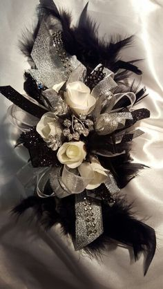 Black white and silver prom corsage from Hen House Designs www.henhousedesig… Black white and silver prom corsage from Hen House Designs www. Black Corsage, Gold Corsage, Prom Corsage And Boutonniere, Brooch Corsage, Flower Corsage, Corsage Wedding, Boutonnieres, Prom Bouquet, Broach Bouquet