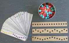 DESCRIPTION:Game related to spatial orientation and fine motor skills. The children complete the pattern based on assignment cards. Includes 3 game boards, 90 colored paper balls and differentiated Montessori Playroom, Indoor Games For Kids, Busy Boxes, Computer Paper, Paper Balls, Colored Paper, Board Games, Game Boards, Fine Motor Skills