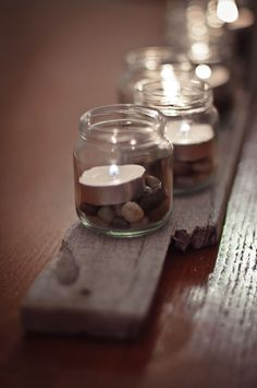 I think I'll do this but with coffee or cocoa beans instead of stones and with twine tied around the top of the jar.