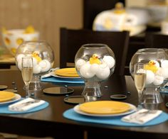 "A Chic Ducky Table - This adorable setting is brought to life with ""floating"" glass and Styrofoam bubbles, tabletop ""bubble bath"" centerpieces, fluffy towels, pint-size terry-cloth robes, bright splashes of auqa and sunny yellow, and of course lots of little rubber ducky friends."