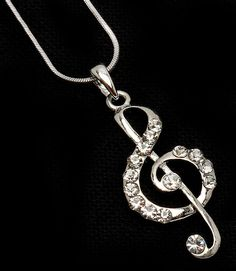 """This necklace has a charm shaped like a music note adorned with crystal studs. The necklace is metal casting with a 1 1/2"""" drop and nickel and lead compliant. Size: 18"""" Long - Color: Clear $29.99"""