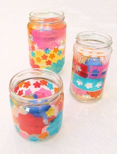 Decoupaged Tissue Paper candle Jar. Could become a lantern by adding wire band and loop handle to brighten the sukkah