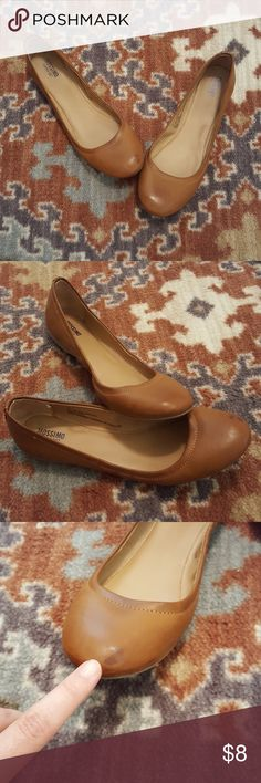 Women's brown flats Mossimo flats. Great shade of brown. Size 7.5 but fit smaller. Show some signs of wear which is shown in pics-dark spot on toe and wear on bottom. Mossimo Supply Co. Shoes Flats & Loafers
