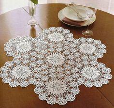 Ажурная салфетка с цветочными мотивами. Openwork cloth with floral motifs |