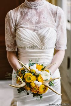 STUDIO DBI - unique bridal bouquet featuring deer antlers, yellow ranunculus, natural cotton, eucalyptus, and billy balls (image by Zac Wolf Photography)
