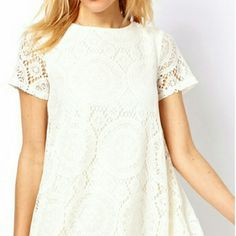 """White Lace Bohemian Beach Dress Soft white lace A-line mini dress, bohemian beach style, Stretchy fabric for a comfortable casual fit. Short sleeves. Slip liner attached. NWOT. Size Large (tag states XL, but true size is L). Measurements: waist 40"""". Chest 36"""". Armhole 18"""". Dress length 27"""" from front neckline. Dresses Mini"""