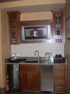 Sweet Small Footprint Wet Bar Area With Glass Front Cabinets TV