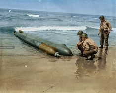 US Army troops examine a one-man submarine that washed up on the Anzio beachhead in Italy.