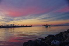 """""""Fall and the Beauty of it All"""" Photo Contest 2013  http://facebook.com/myforgottencoast   11-28-13 Shrimper going to work, in the beauty, of a gorgeous sunset. The Shrimper is going through Sike's Cut, at St. George Island, FL   Photo Credit: Joan Harlow..   Amateur Division: St. George Island, FL"""