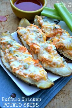 Buffalo Chicken Potato Skins topped with cheddar cheese & blue cheese and baked to perfection