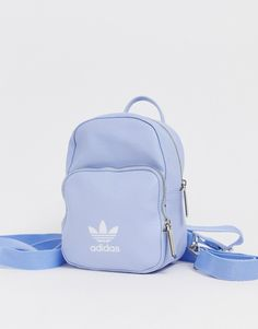 Buy adidas Originals mini backpack in pale blue at ASOS. Get the latest trends with ASOS now. Mochila Louis Vuitton, Louis Vuitton Rucksack, Michael Kors Rucksack, Yellow Backpack, Backpack Outfit, Diaper Bag Backpack, Prada Backpack, Mini Backpack Purse, Crochet Backpack