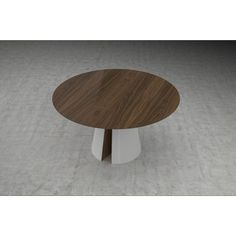 A profiled walnut edge gives the tapered, ultrathin circular top of the Tottenham Dining Table a subtle, traditional look, while the white-lacquered conical base and its two cutouts add a modern visual surprise.