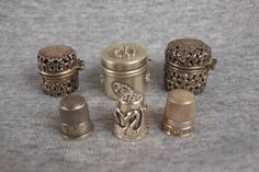 Sterling lot of 3 thimble holders and 3 thimbles