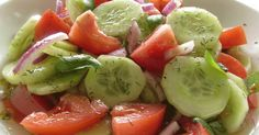 A simple, healthy recipe for cucumber tomato salad with red onions, basil & a homemade vinaigrette dressing.