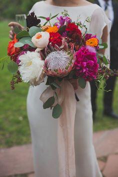 wedding bouquet with protea - photo by Harper Point Photography http://ruffledblog.com/outdoor-bohemian-colorado-wedding