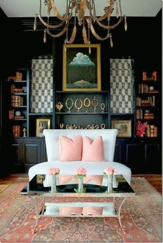Rethinking Pink | 25 Interiors Featuring Beautiful shades of Pink | Amy Howard - Chic Library | Black Bookcase Painted Benjamin Moore Raccoon Fur  2126-20 - a beautiful soft shade of black paint