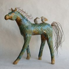 Artist Michelle MacKenzie  - Ceramic horse sculpture with birds and copper mane and tail