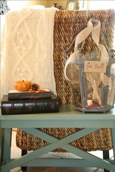 Twisted grapevine adorn the gorgeous Monarch Lantern. Place a fall bundle inside and adorn it with a lighted votive. Add a finishing touch of burlap ribbon and you have a dramatic fall piece that can be added to any decor/room.