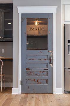 Antique door repurposed as pantry door - or basement door...by Rafterhouse.