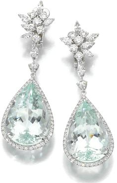 Aquamarine and diamond earrings by Margherita Burgener. Each foliate diamond surmount on suspends a pear-shaped aquamarine within a border of brilliant-cut diamonds. Via Diamonds in the Library.