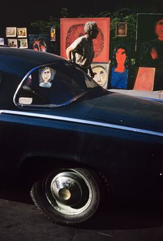 Ernst Haas, New York, 1952 ---- I like this image because it's simple yet interesting. The use of colour to emphasise the image and the use of the car windows to frame the portrait of the girl, gives more meaning to image is also inspiring.