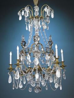 So chic! Stunning rock crystal drops distinguish this outstanding 18th-century chandelier. A network of rock crystal beads create a lace-like effect. Rock crystal has enjoyed a prominent place in the decorative arts for its rarity and beauty. This fixture is pictured in the rare, authoritative Parisian interior design volume by Henry Havard. Circa 1780 #30-0625