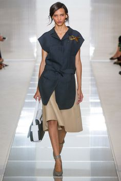 """""""The prints that made Marni's name no longer seem to interest Castiglioni as much as proportion, and the best way to illustrate that is with a monochrome palette, a conclusion which, thanks to Cristobal Balenciaga, feeds the essence of haute couture."""" Tim Blanks"""