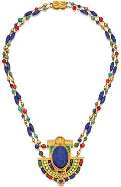This is a rare necklace designed by Louis Comfort Tiffany in 1913. The piece is set in yellow gold with a large carved Lapis lazuli and turquoise, amber and green stone beads.