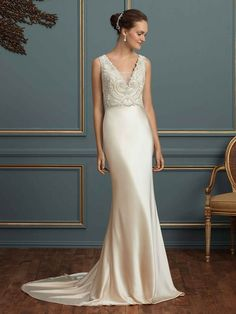 Oozing with understated glamour, Charlotte features a heavily beaded bodice with a plunging V-neckline offering an illusion panel. The deep V-back of this silk ...