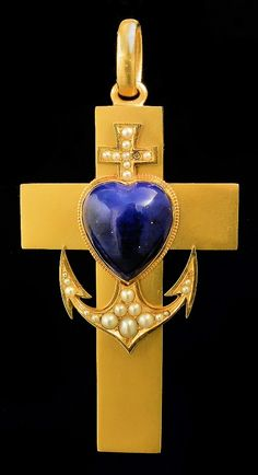 """A Victorian gold coloured metal mounted lapis lazuli and seed pearl set cross pattern pendant, emblematic of """"Faith, Hope and Charity"""", the face set with a heart shaped lapis lazuli boss surmounting a seed pearl set anchor"""