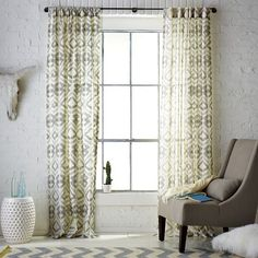 love the white brick with the subtle accents!! Want these curtains from WE! :)
