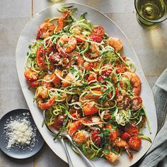Easy Shrimp Scampi with Zucchini Noodles Enjoy classic shrimp scampi lightened up with a white wine-butter sauce and zucchini noodles in place of pasta. The tomatoes add some sweetness and color, while the cheese contributes nuttiness and richness. 400 Calorie Dinner, Easy Shrimp Scampi, Easy Mediterranean Diet Recipes, No Calorie Foods, Cooking Light, Diet Meal Plans, Seafood Recipes, Noodle Recipes, Drink Recipes