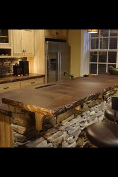 Stained concrete counter. Holy cow I want this kitchen!
