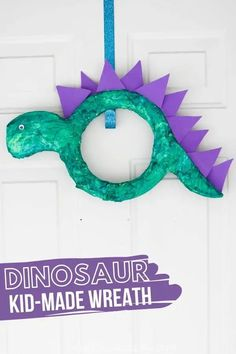 This Dinosaur Wreath is a super simple dinosaur craft for kids to make, whether to add to a Dinosaur themed bedroom, Dinosaur party or give as a fun Father's Day gift | Easy Crafts for Kids