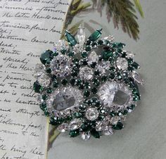 SHERMAN Signed Large Clear Crystal & Green Rhinestone Brooch OAH32 by CornermouseHouse on Etsy https://www.etsy.com/ca/listing/524503233/sherman-signed-large-clear-crystal-green