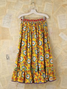 "Free People Vintage Bright Floral Skirt, $168.00    Cotton.  Button closure on right side of waist.  Bottom of hem is ruffled with contrast patterned trimming.  Waist 25"".  Length:  33 1/2"""