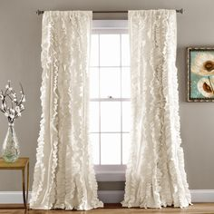 Flowing hand crafted vertical ruffles turn the ordinary into a beautiful window. The fabric is so soft and lays down beautifully from top to bottom. Part of the Belle Collection. - Includes: 1 Panel -