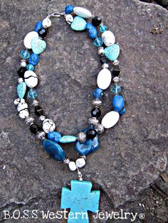 12 $-- Necklace  6 $-- Pendant  This is a black and turquoise 2 stranded necklace accented with silver indian findings finished with a chunky chopper cross pendant!