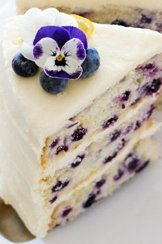 Tender layer cake recipe brightened with lemon juice, lemon zest and wild blueberries, frosted with a tangy sweet lemon cream cheese frosting.
