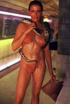 Joanna Cassidy (Zhora) in #BladeRunner (1982) was at ease with the snake around her neck as it was her pet, a Burmese python named Darling.