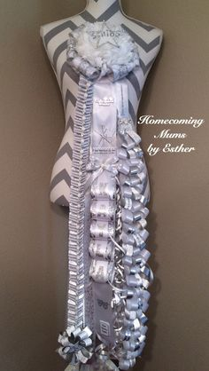 All white and silver Senior homecoming mum.
