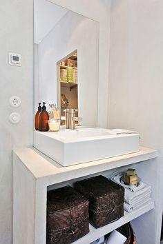Minimalist industrial bathroom. Open shelving and baskets.